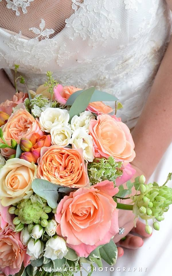 Coral and peach bridal bouquet at Frensham Heights - Image by Paul Magee.  Flowers created by Eden Blooms Florist from Miss Piggy Rose, Peach Avalanche, Peach Garden Rose, Cream Spray Rose, Cow Parsley, Pittosporum & Ornithogalum.