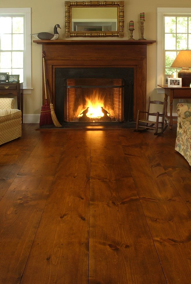 Wide plank wood floors.  Tobacco stain.