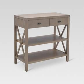 For a great and versatile piece of furniture, look no further than the Owings Console Table from Threshold™. This double shelf rustic console table with two drawers provides that extra storage space you need in your living room, home office or bedroom. Whether you are looking for a functional and decorative hallway table or a sturdy alternative to a traditional TV stand, you won't regret making room for this wood-framed console table in your home.