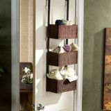 There are so many ideas for utilizing back of door storage- why not utlize front of door space with an over the door basket organizer like this one?  organization.  storage ideas. interior design. small spaces. apartment therapy. bathroom decor.