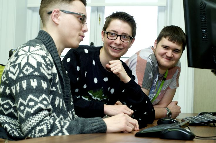 Three ICT students working together while they do research for their assignment.