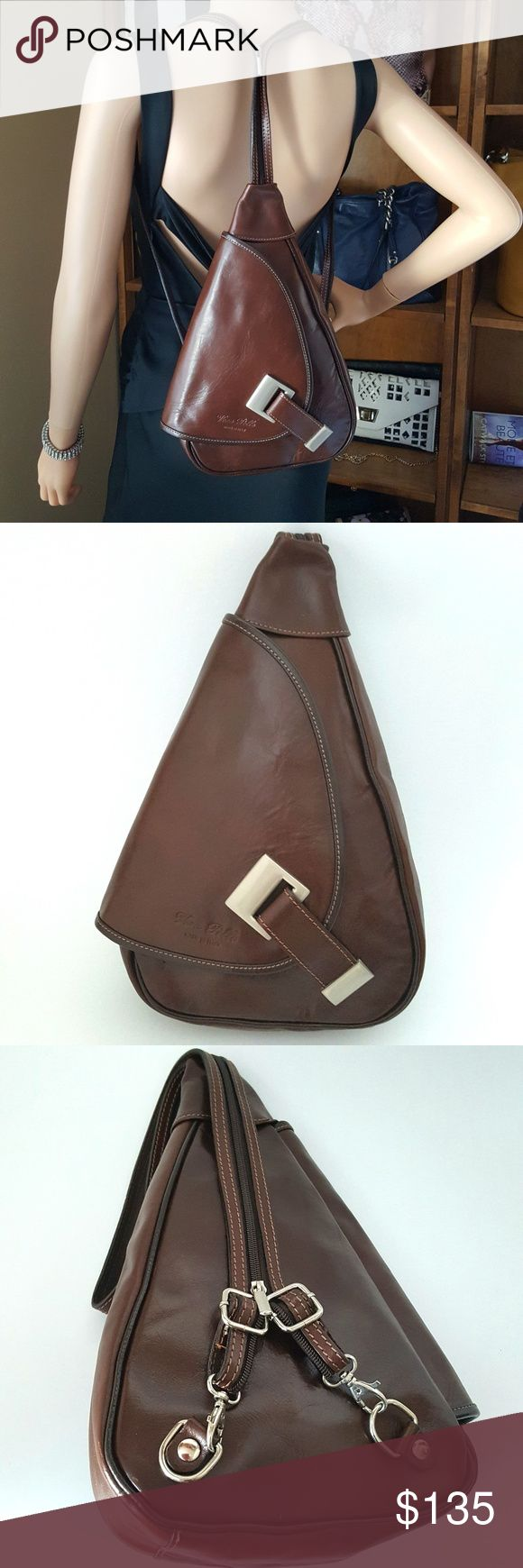 """Vintage VERA PELLE Made In Italy Leather Backpack 1980's Vera Pelle backpack. Company Vera Pelle only produces exclusive leather goods. Rich chocolate brown leather. Silvertone hardware.  Adjustable and versitile 28"""" shoulder strap/sling. Approx. 13"""" x 8"""" x 3"""". Magnetic closure. Brown interior lining. One interior and exterior zip pocket. Very good to excellent vintage condition. Minimal superficial scratches. Please review all photographs as a part of the description and condition. Vintage…"""