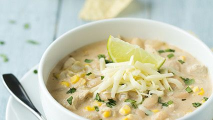 Perfect for our current weather conditions!    2cans of chicken broth  3cans of northern beans  2cans of corn  2cans of tomatoes  2cloves of garlic  2medium onions  1tablespoon of oil  1 4oz can of chopped green chilies  2 teaspoon of cumin  1 1/2 teaspoons of oregano  1/4 teaspoon of cayenne pepper  1/4 teaspoon of ground cloves  4-6 chicken breasts diced up  Monterrey jack cheese    In oil sauté onions, garlic and spices. When