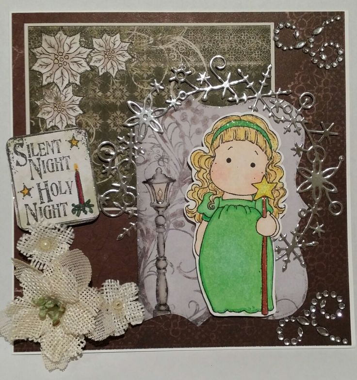 Challenge 35 - Die Cuts. I used Heartfelt Creations Frosted Blanket paper with the silver snowflake die cut from my sister in law. Tilda has stickles on her headband, staff and star. Flowers are Petaloo.  The sentiment is LOTV which I distressed using Old Paper distress ink and I added some crystal swirls.