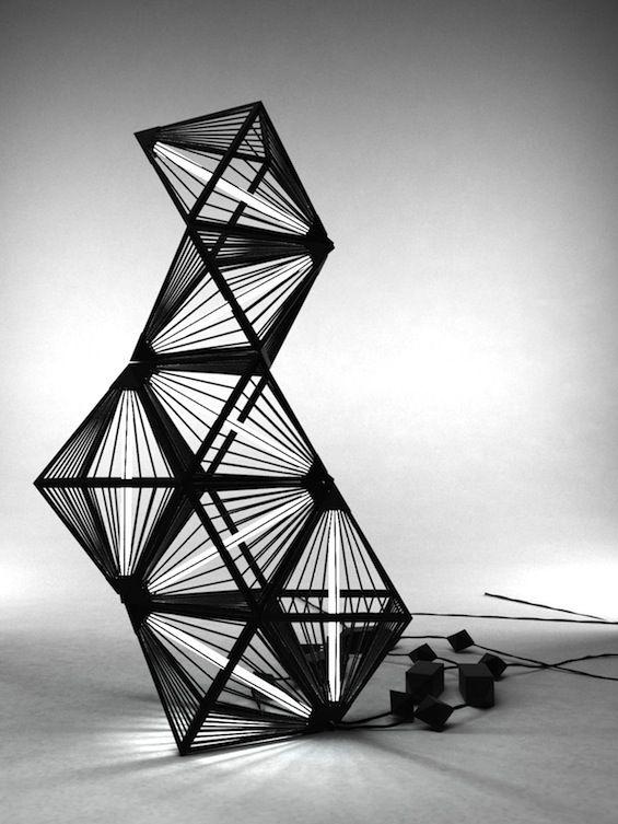 luminaire design crée par Léa Padovani et Sébastien Kieffer. Il a des courbes inspirées d'un diamant.