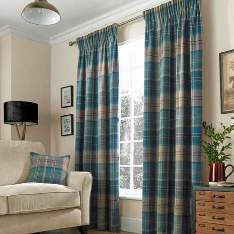 Featuring a textured effect in rich teal, these striking ready made curtains are fully lined with a traditional pencil pleat header....