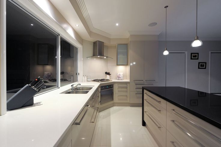 1141 Pure White benchtops ceaser stone.  Coloured cabinets