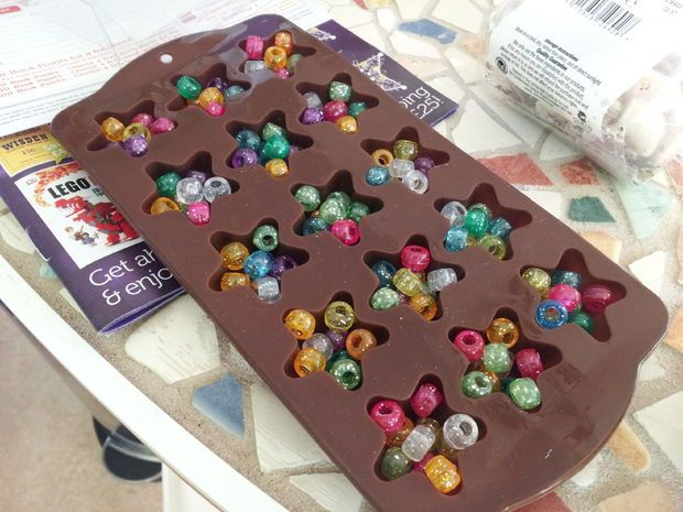 Melting pony beads into silicone molds used for ice cubes and baking