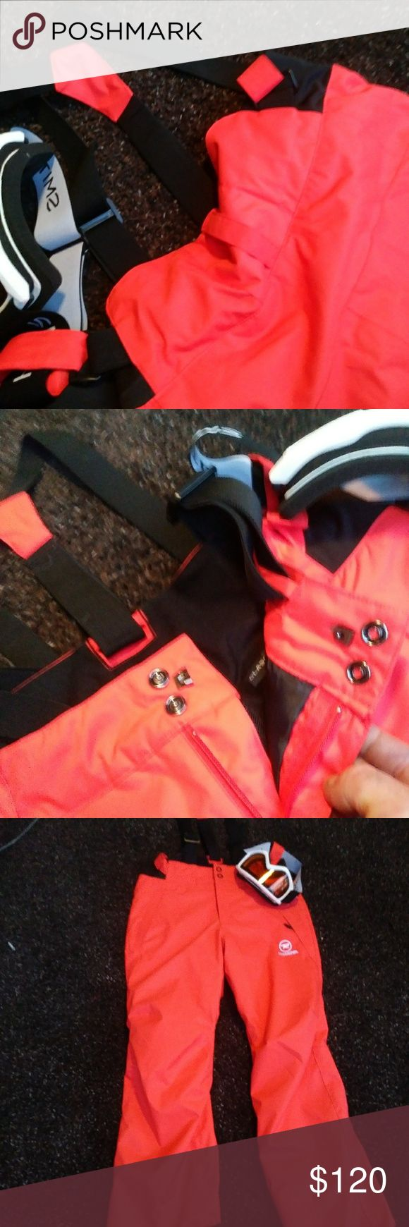 Ski pants Glo orange double insulated with overalls . comes Smith goggles. Everything in pristine condition . will fit up to 38 waist perfectly. Rossignol Pants