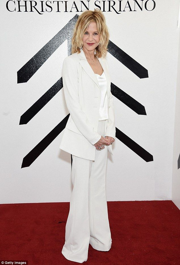 Still a siren: Meg Ryan looked incredible on the red carpet in a tailored white suit with bell-bottom pants as she hit Christian Siriano's show in NYC