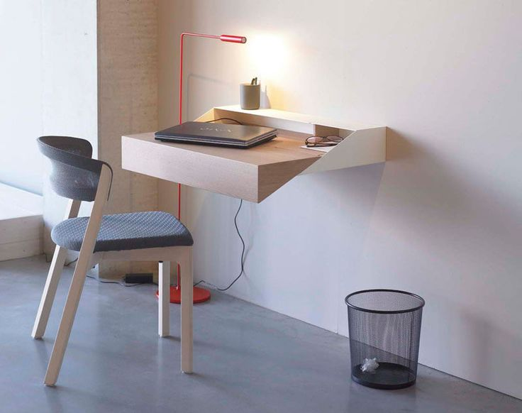 16 Wall Desk Ideas That Are Great For Small Spaces // This minimal geometric floating wall desk is just the right size for studying or paying the bills.