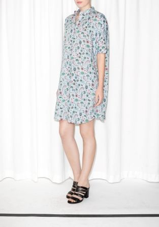 A comfy, oversized dress featuring a buttoned front, short sleeves and side seam pockets.
