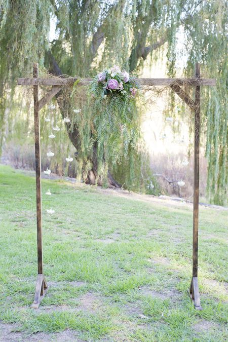 Dyi wedding arch. Add a white sheet draped over and some flowers going down