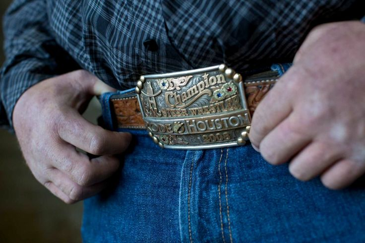 HoustonChronicle.com: Rodeo competitors show their pride with trophy buckles. Steer wrestler Wade Sumpter wears his 2008 RodeoHouston Championship buckle.