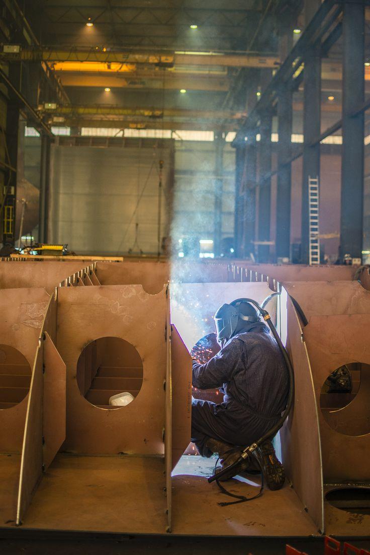 Welder working in a shipyard  Photography: Jeanine Polderdijk for ComMediArt