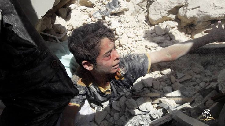While half of his body is buried in the ground, he asked rescuers to leave him and save his family, which are still under the rubble