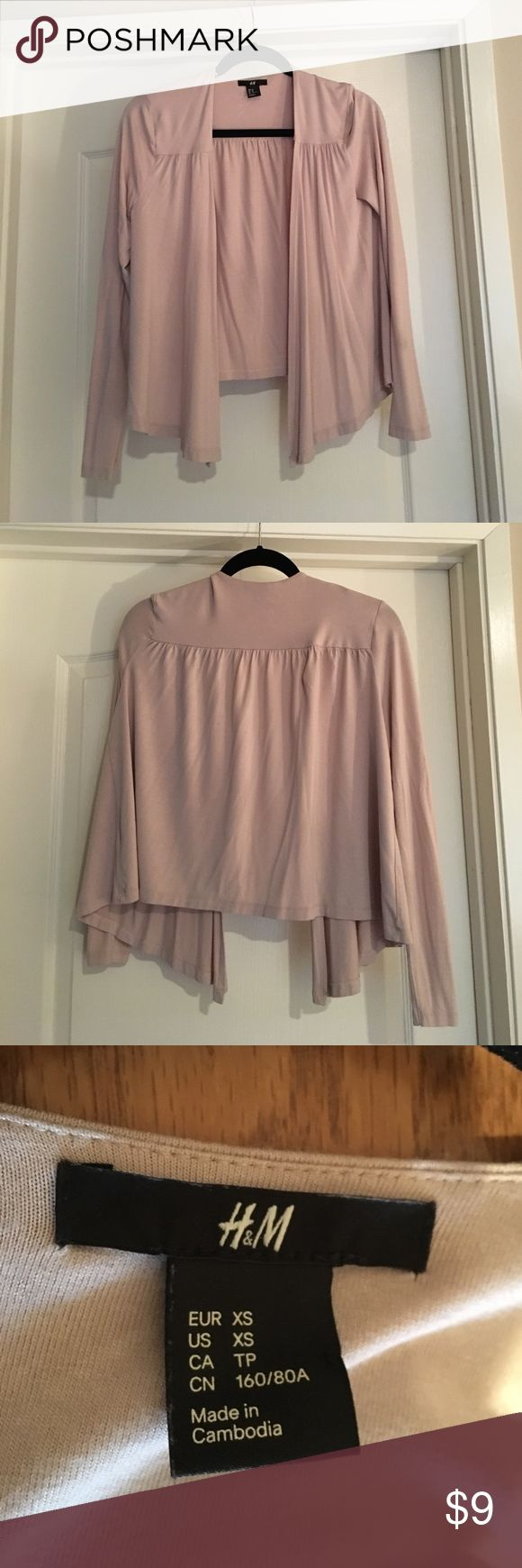 H&M women's top size extra small H&M beige women's top size extra small. Used. Good condition. Made in Cambodia. Open in front, with no buttons. Sorry, the tag about fabric and Care has been removed. H&M Tops