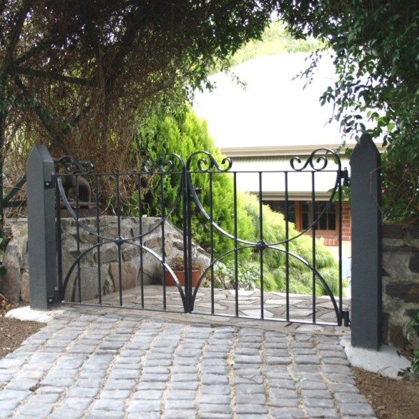These wrought iron gates are quite petite, at only 600mm tall. Crafers, Adelaide Hills, South Australia