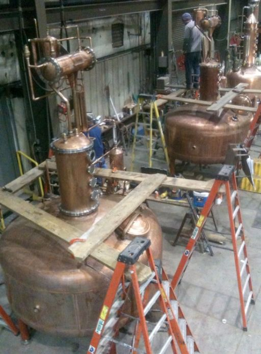 These copper pot stills are captured as they are getting ready for their trip to Stranahan's Distillery | BourbonBlog