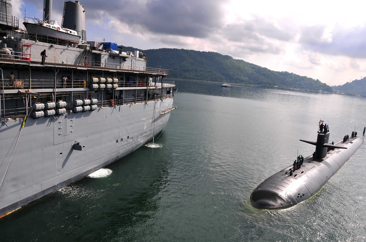 The Los Angeles-class attack submarine USS Louisville (SSN 724) maneuvers alongside the submarine tender USS Emory S. Land (AS 39) in Sepangar, Malaysia. (U.S. Navy photo by Mass Communication Specialist Seaman Apprentice Samuel Souvannason/Released)