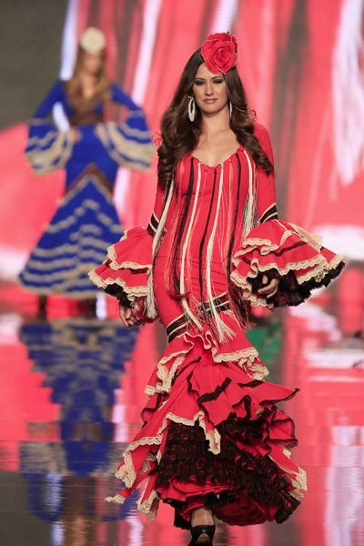 A model presents a creation by Aurora Gavino & Mary Paz during the International Flamenco Fashion Show (SIMOF) in the Andalusian capital of ...