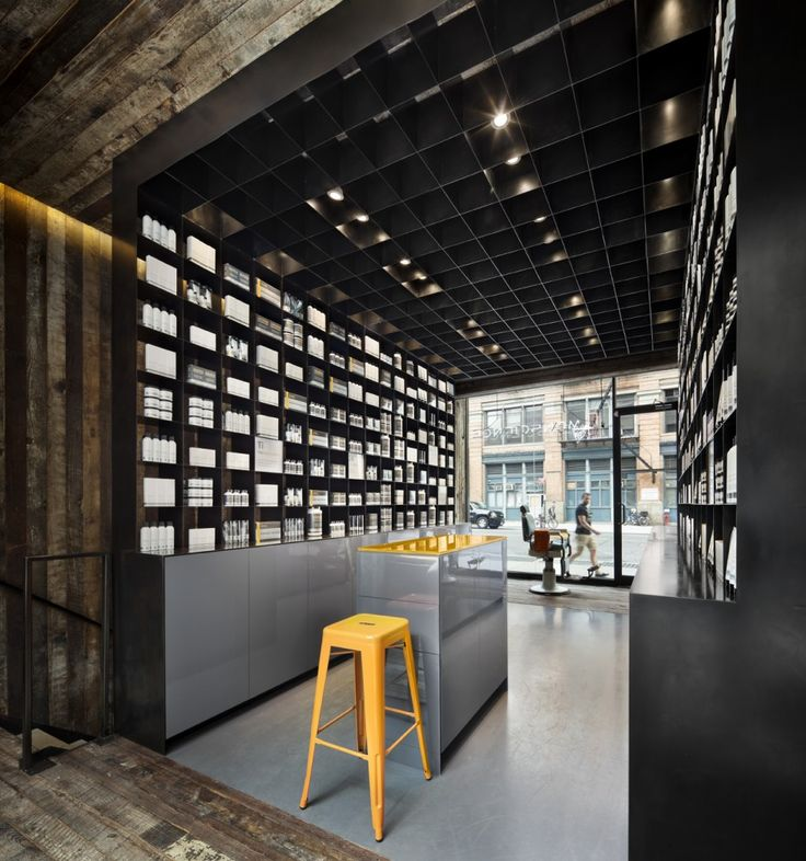 MenScience Flagship Store by HWKN.  The blackened steel and rough wood work so well together.  Also the small splash of color in the center is great.
