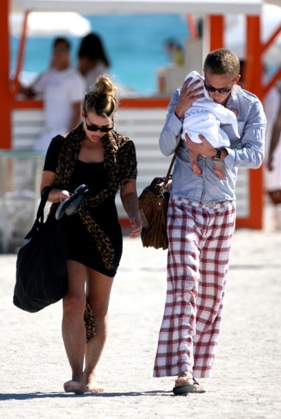 Billie Piper and her husband enjoy a day out on Miami Beach with their newborn baby.