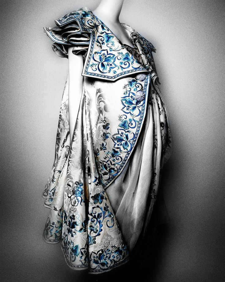 House of Dior (French, founded 1947). John Galliano (British, born Gibraltar, 1960). Ensemble, spring/summer 2005 haute couture. Coat of white silk jacquard embroidered with blue and white silk thread; dress of white silk organza embroidered with crystals, gold and green silk, and silver metallic thread. Courtesy of Christian Dior Couture | Photography © Platon #ChinaLookingGlass #AsianArt100
