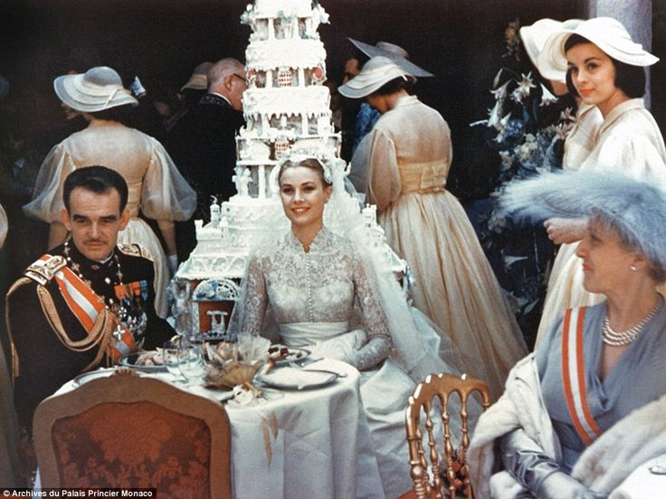 Happy couple: Prince Rainier was so nervous during the televised ceremony that Kelly had to help him slip the ring onto her finger. But he made up for his nerves after the event by cutting their wedding cake with his ceremonial sword