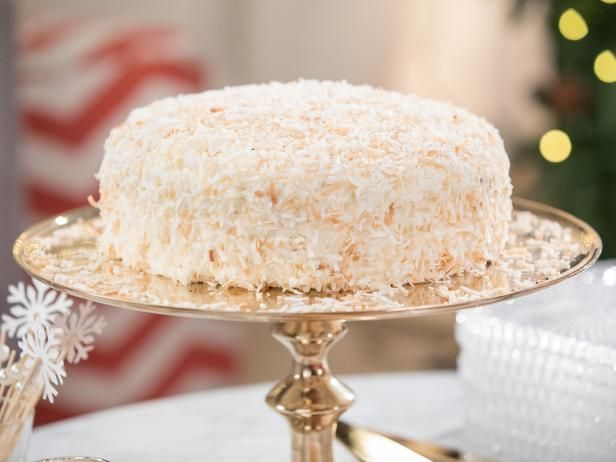 Chocolate Coconut Cake Recipe -- Coconut cakes are typically w/ white or yellow cake, and not very exciting.  This version w/ chocolate sounds wonderful, and looks like a snowball!  Excellent for holiday parties and easy to make!