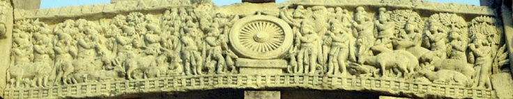 This is the middle archway of the western gateway. This  middle archway is the BUddha  delivering a sermon. Buddha is represented her as the wheel. This symbolism refers back to his first sermon, the four noble truths when he set the wheel of dharma in motion.