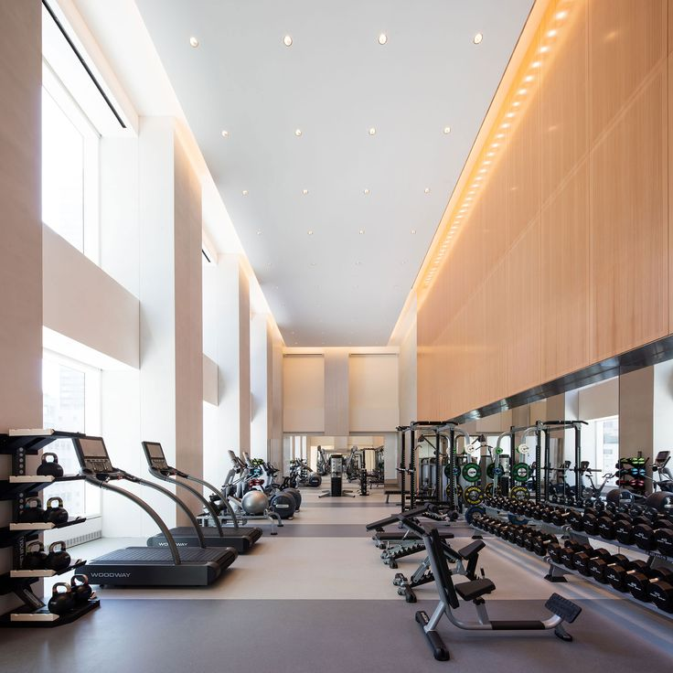 The space is a very open, clean, safe environment. There is a lot of equipment, the room has neutral colors. The equipment looks modern. It has a minimalist style and it is the perfect place to workout.
