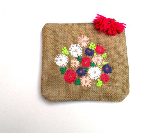 Colorful pastel flowers hand embroidered on burlap by Apopsis