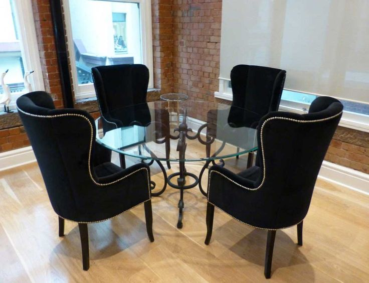 Awesome black wing back dining chair with round glass dining table | Home Interior & Exterior