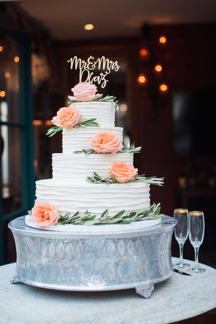 Wedding Cake with Mr. & Mrs. Cake Topper and flowers. Kiel Rucker Photography.