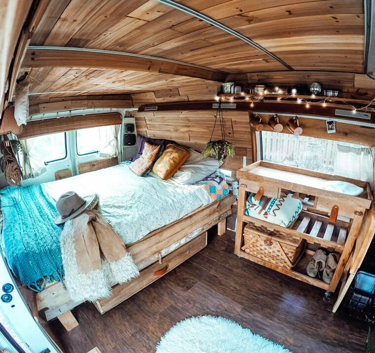 I love the camper van build here! It has cool rustic layout made of cedar panels on the ceiling and recycled wood shelving. The perfect campervan! I want an interior like this!