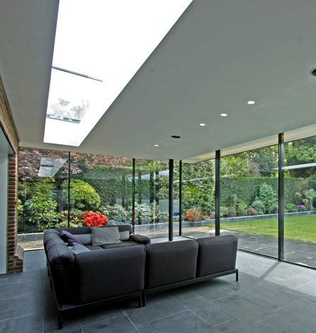Using slim frame sliding glass doors with structural glass for a modern design.
