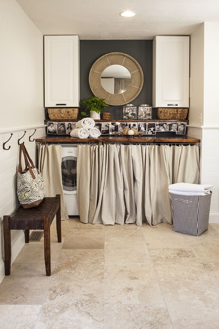 Super cute laundry nook. I love the wood countertop over the washer/dryer...the dark accent wall with the mirror and the pictures! | House*Tweaking http://www.tileshop.com/bloggers/housetweaking.aspx  #homeorganization