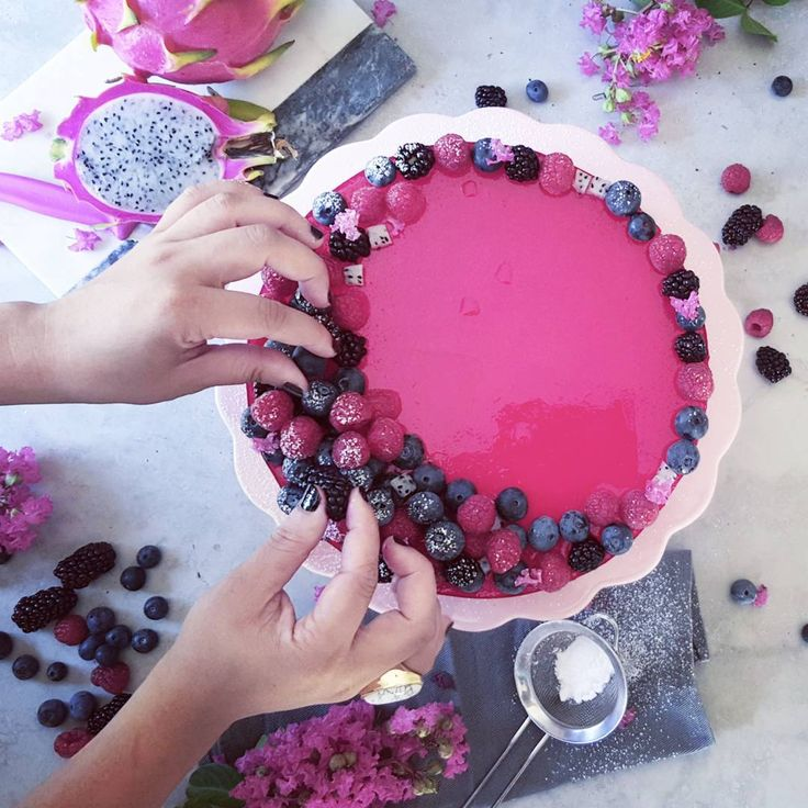I couldn't get the idea of topping a no-bake Cheesecake with jelly out of my mind. The combination of flavours and textures are very interesting and add a playful element to the traditional cheesecake.  I also whipped a packet of raspberry jelly into the cheesecake mix before leaving to set.  The result; a marshmallow-y pink tinted cheesecake with an intense pink layer on top. I'd imagine this working well with a lemon filling topped with passionfruit pulp too!