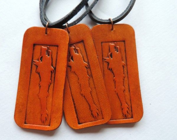 Stamped leather pendant with draco, the Dacian wolf