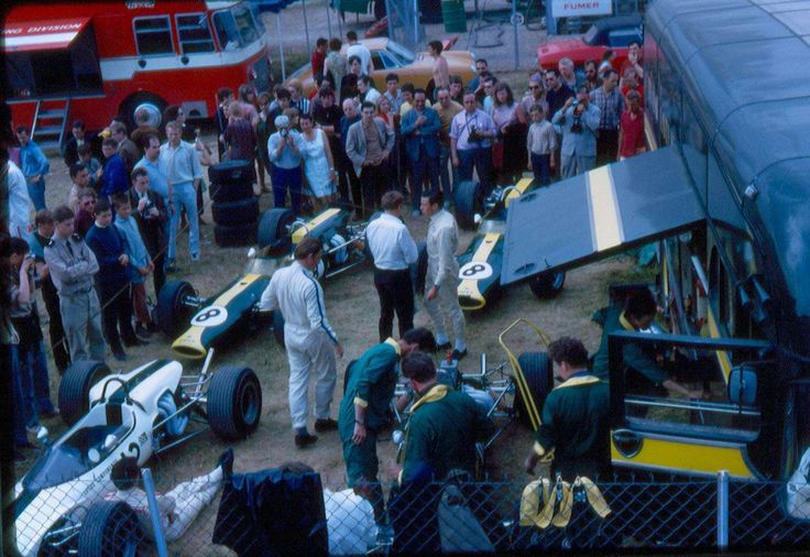 """Jackie Oliver is seated against his Lotus' front wheel, Graham Hill walk around his car and Jim Clark his quietly preparing his race"" : (12) Jackie Oliver -  Lotus 41B Cosworth FVA - Lotus Components Ltd - (8) Jim Clark - Lotus 48 Cosworth FVA - Team Lotus - (10) Graham Hill - Lotus 48 Cosworth FVA - Team Lotus - XXXIII Grand Prix de Reims - 1967 Trophées de France (F2), Round 2 - © Alain Foreau"