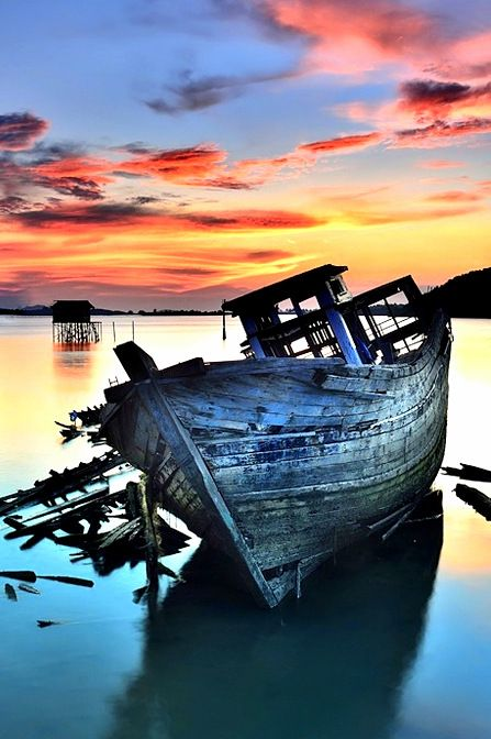 Old ship at sunset or rise