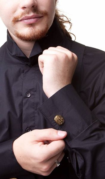 Gold & Black Cufflinks. These will set off any steampunk or neo-Victorian look.