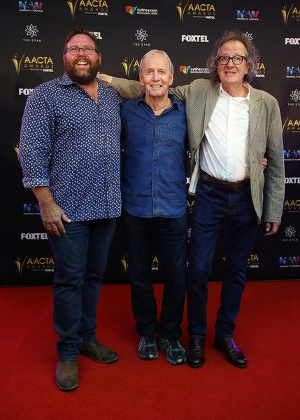 Geoffrey Rush Photos Photos - Paul Hogan, Shane Jacobson and Geoffrey Rush pose after Paul Hogan is announced as the 2016 AACTA Longford Lyell Award recipient at Dawes Point Park on December 6, 2016 in Sydney, Australia. - 2016 AACTA Longford Lyell Award Winner Announcement