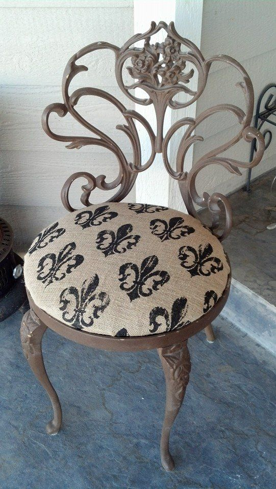 Burlap covered wrought iron chair.