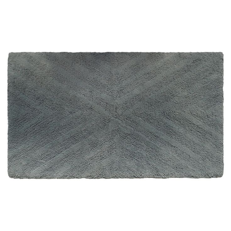 Treat your feet to toasty comfort with this Nate Berkus Bath Rug. This thick, luxurious rug features machine-tufted 100% cotton pile. It comes in a generous 34x20 size and is machine washable.
