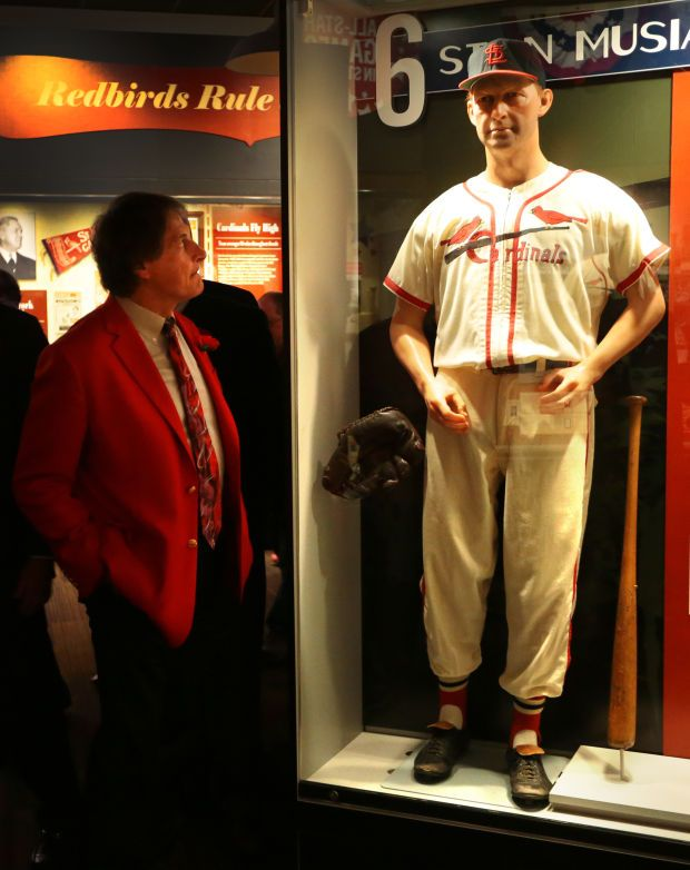 Cardinals Hall of Fame opens Retired Cardinals manager Tony LaRussa looks over a Stan Musial exhibit during a tour of the new Cardinals Hall of Fame inside Ballpark Village on Monday, April 7, 2014. Photo by Robert Cohen, rcohen@post-dispatch.com