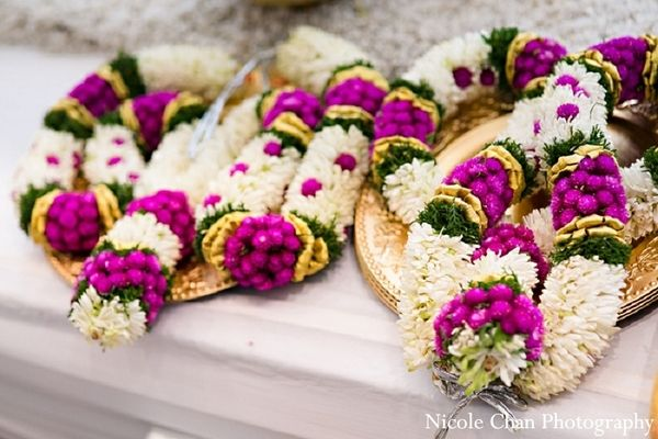 An Indian bride and her groom at their wedding ceremony. OUR CEREMONY GARLANDS