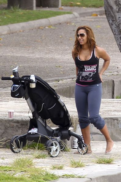 "Melanie Brown Photos Photos - Melanie ""Mel B"" Brown takes her youngest daughter Madison (b. September 1, 2011) for a walk in her stroller with her nanny. - Mel B Pushes the Stroller"