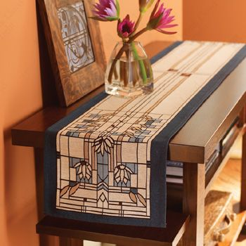 A waterlilies table runner pays tribute to the arts and crafts style and brings stylish symmetry to this side table.